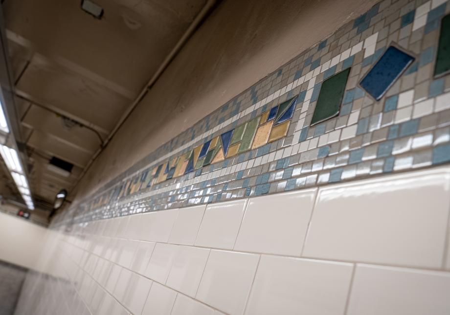 Photo of the restored tile work at the 168 St 1 station