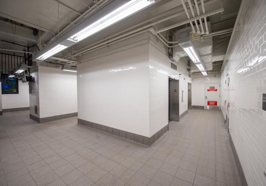 Photo of the new elevators and retiled station walls at the 191 St 1 station